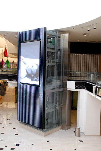 Installations inside, glass elevators with display